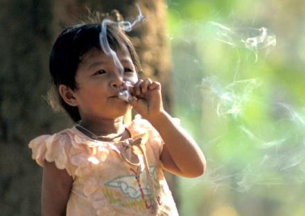 WHO/Jim Holmes  Young girl smoking, Lao People's Democratic Republic (2008)